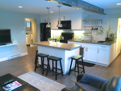 Modern, open kitchen with concrete countertops!