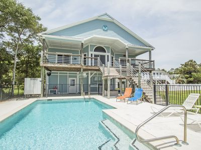 Photo for Waterway views with private pool and private dock