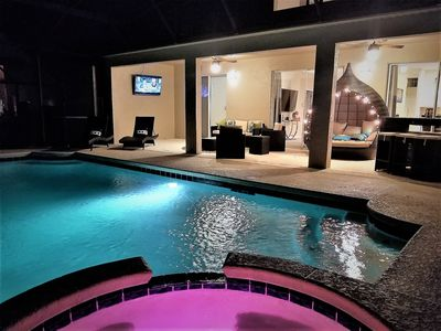 Photo for NEW!!Waterfront Luxury 4 Masters,South Facing XL Pool,HOT TUB ,Arcades, Theater