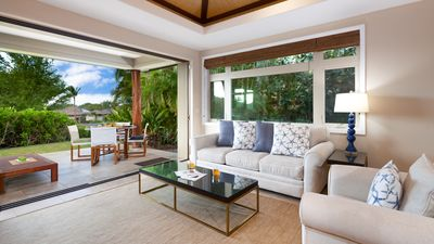 Open Concept Living Room opens to Lanai and lush gardens