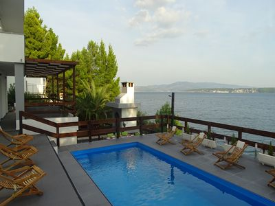 Photo for Dreamlike seaside villa with pool next to the sea