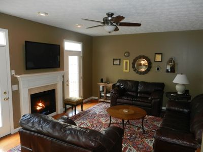 Main Living Room - gas fireplace, 52' HDTV with access to rear deck.