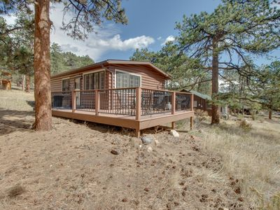 Photo for NEW LISTING! Ideal vacation home w/wraparound deck & Rocky Mountain view