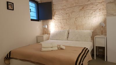 Photo for Tranquil oasis beautiful stone home in central Ostuni. Rooftop terrace. WIFI.