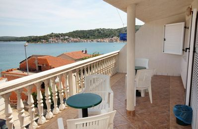 Photo for Two bedroom apartment with terrace and sea view Tisno, Murter (A-5086-d)