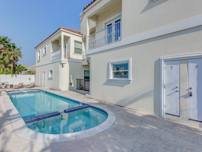 Photo for Dog-friendly condo w/ shared pool - one block from the beach
