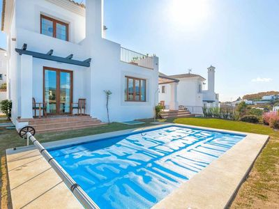 Photo for Amazing golf courses view! Scandinavian villa for up to 14 pax, HEATED POOL