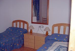 One of the three twin bedded rooms