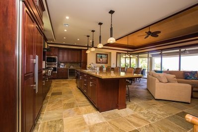 Enjoy cooking in this beautiful gourmet kitchen with Wolf gas six burner cooktop