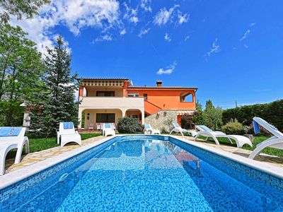 Photo for This 4-bedroom villa for up to 8 guests is located in Labin and has a private swimming pool, air-con