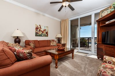 Spacious gulf front living room with plenty of seating for your family.