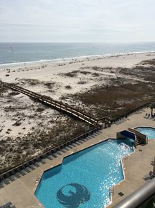 View of pool and gulf from balcony.