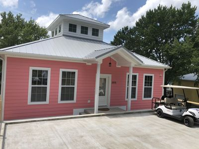 The PInk Home. Waterfront and comes with a dock.