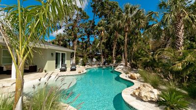Photo for Tropical Oasis - A brand new home with heated over-sized pool!