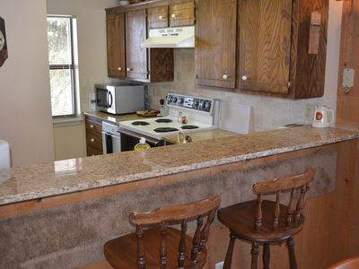 Kitchen with granite breakfast bar