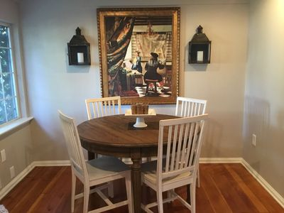 European style dining room, with flame less remote candles, oversized artwork