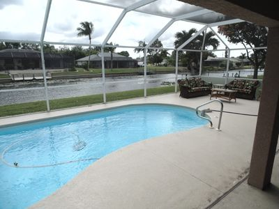 Photo for Southern Exposure 3 bedroom 2 Bathroom Pool home on a wide Fresh Water Canal!