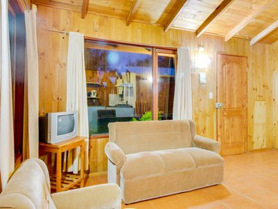 Photo for Cozy cottage w/ a shared pool. Near Lake Villarrica and the heart of town!