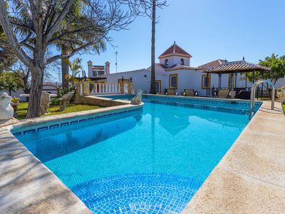 Photo for Elegant villa with stunning views & private pool, short distance from town!