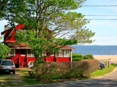Steps from private beach, screened-in wraparound porch, water views.