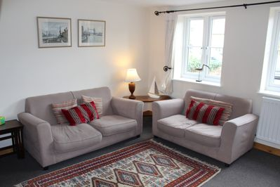 The sitting room provides a charming and comfortable area for relaxing in.