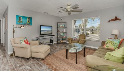 Gorgeous vinyl floors throughout this adorable condo features a spacious living room with microfiber sofa, 2 cozy chairs and large flat screen TV.
