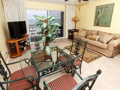 Photo for Pelican Isle 315: Beautiful beach front, free beach chairs, MUST SEE!