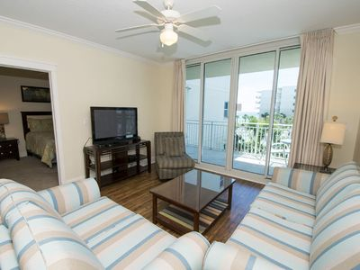 Photo for Cute Condo Overlooking Tropical Pool Area and View of the Gulf!! ~ Steps to the Beach!
