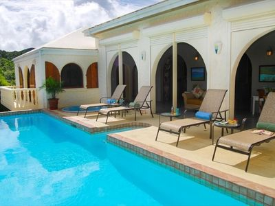 Relax by the pool and spa while enjoying the views to Cinnamon Bay and Tortola