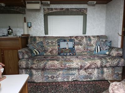 Sofa bed in living room facing the river when seated.  Helps make all Better!!!