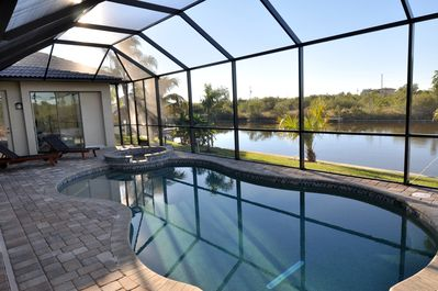 Pool and lanai with view of canal