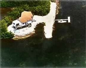 the peninsular house off Grassy Key harbor, surrounded by water on all sides.