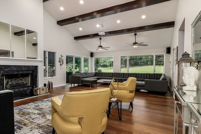 Beautiful Living Room with custom leather sofa that seats up to 20 guests.