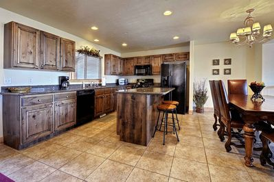Full kitchen with everything you need and expandable dining table that seats 8.