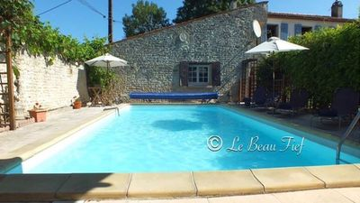 Photo for Detached cottage with private heated pool and  pretty walled courtyard