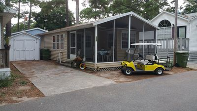 Front of house with golf cart