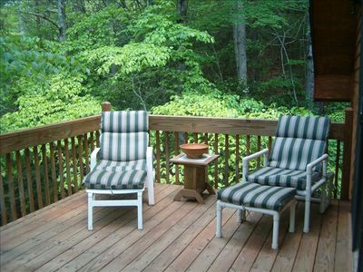 Deck  which  has  more seating at other end & overlooks wooded  area