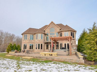 Photo for Castle at the Lake- Luxury Lakefront Pet Friendly Home with Indoor Pool