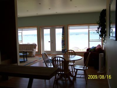 Interior dining area and living area with beach at doorsteps