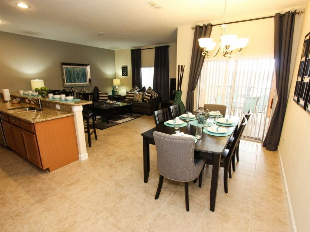 Beautifully and professionally furnished 2-Story town home with a screened private pool and covered lanai.