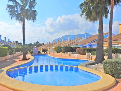 Photo for Beautiful, beachfront apartment overlooking pool and the mountain 'Segaria'