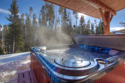 Our outdoor private hot tub nestled in the mountains directly adjacent to slope