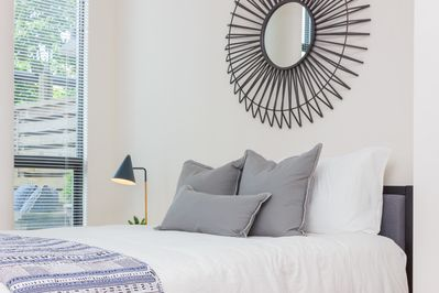 Stylish design and comfortable queen bed with cozy bedding.