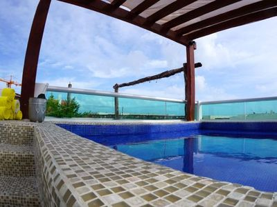Photo for MAGIC PARADISE MAMITAS BEACH AREA,  Ocean View from rooftop & Private Pool