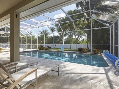 Photo for Private Gem - 2 Miles to Beaches! Private Heated Pool - Gorgeous Updated Home