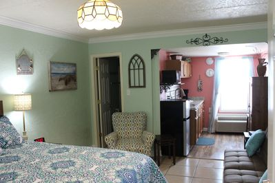 Our quaint little condo, decorated with wrought iron & hints of New Orleans!