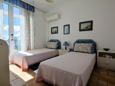 Photo for Beach front maisonette  in a private complex with communal pool & playground