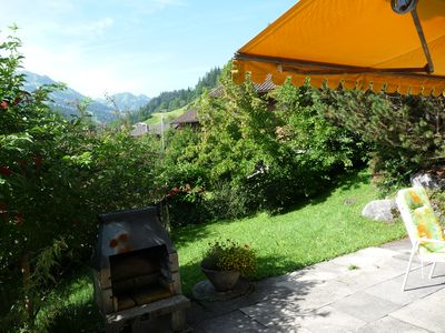 Photo for Chalet on a sunny hillside with beautiful view on the village and the mountains