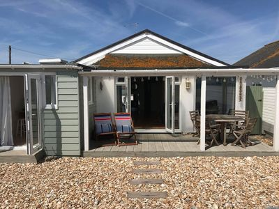 """Photo for Idyllic """"railway carriage"""" beach house in the historic Sussex village of Pagham."""