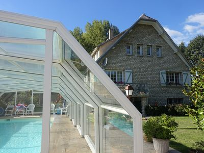 Photo for Villa of 160m2 - plot of 1300m2 - covered swimming pool in Ile-de-France Yvelines